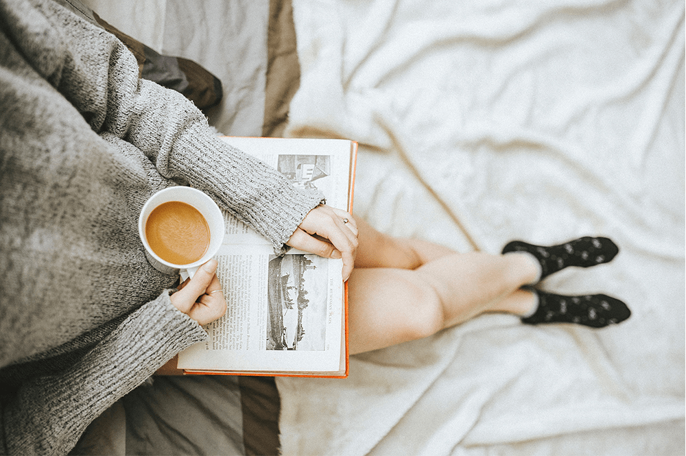 drinking a cup of coffee or tea and reading a book is the perfect way to practice mommy self-care
