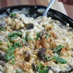This Roasted Garlic Mac & Cheese is an easy, cheesy creamy dish that's a perfect frugal recipe for large families. Eat gourmet without breaking the budget!