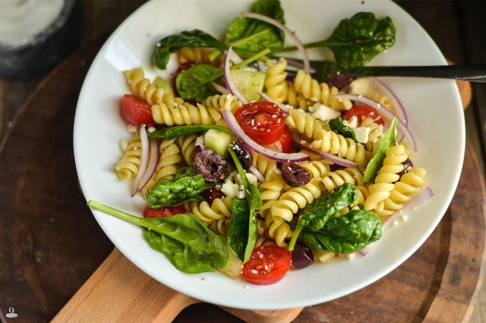 Here's one healthy salad recipe for picky eaters. This Greek Pasta Salad is loaded with fresh veggies, Kalamata olives, feta cheese and the dressing YUM!